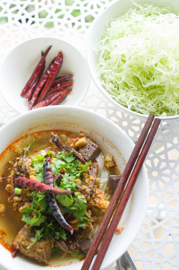 Vermicelli eaten with curry and Khao Soi Nam Ngeaw in Thai name. Traditional Northern Thailand Food White Noodles Spicy Soup in a Bowl, Khao Soi Nam Ngeaw stock photography