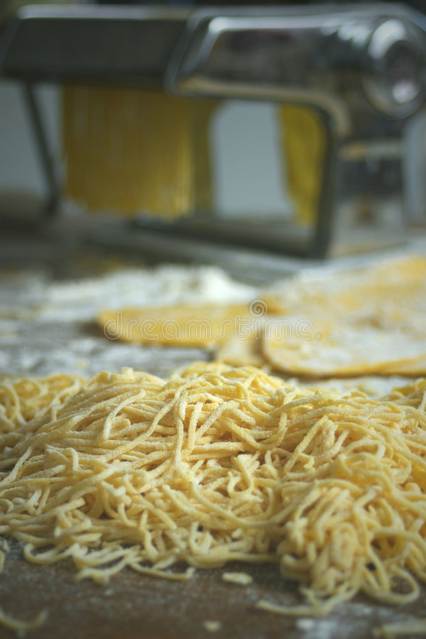 Vermicelli pasta. Home made vermicelli pasta with pasta machine stock image