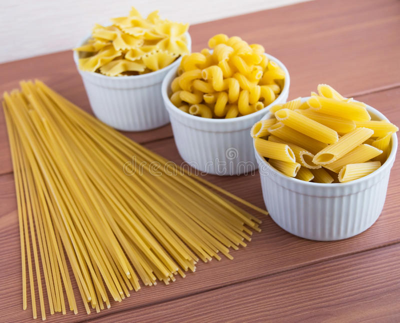 Vermicelli (Pasta). Different kinds on the wooden desk royalty free stock photo