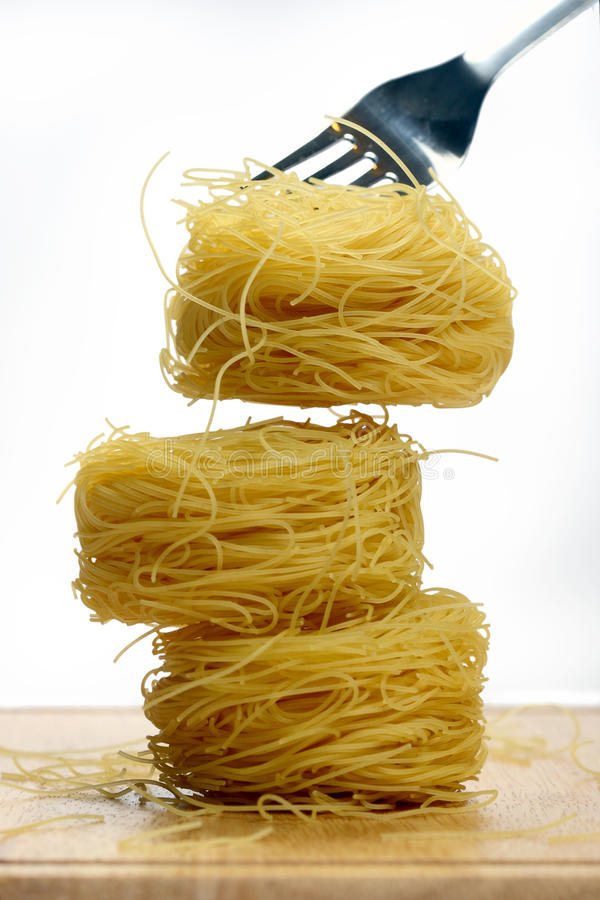 Vermicelli pasta nests. On white background stock photos