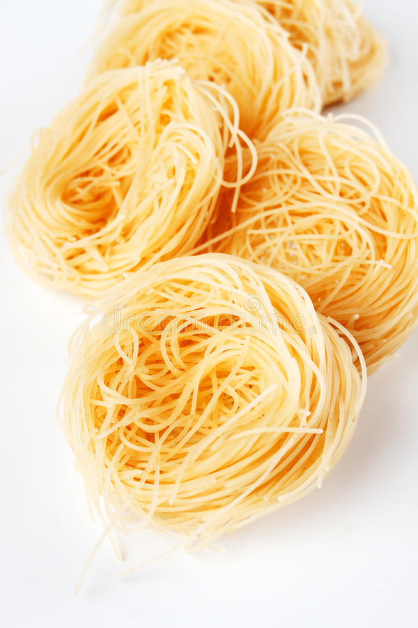Vermicelli pasta nests. Raw vermicelli pasta nests over white background royalty free stock images