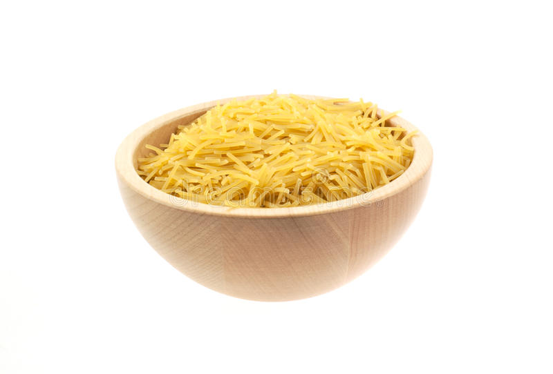 Vermicelli pasta in a wood bowl. White background stock photography