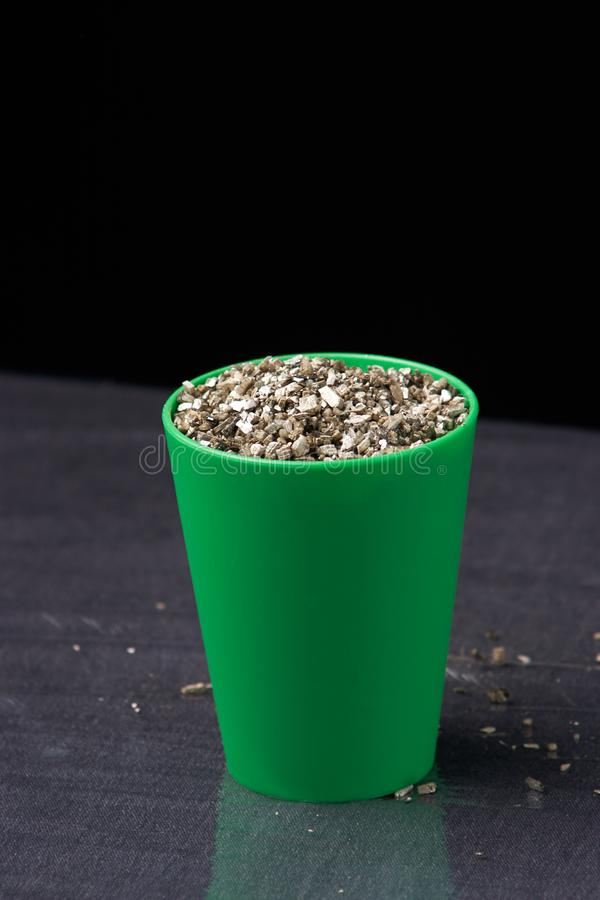 Vermiculite in green pot. Close up. Soil growing cannabis. The concept of growing medical cannabis stock images