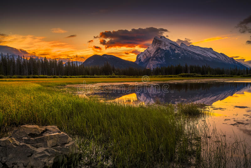 Vermilion Lakes Sunrise near Banff. Golden early fall sunrise over the Canadian Rockies and Vermillion Lakes on the outskirts of Banff, Canada stock images