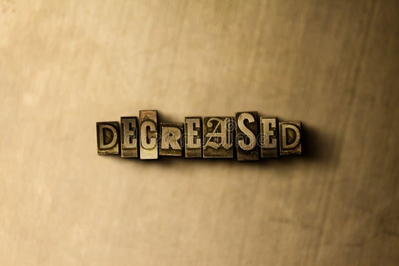 VERMINDERD - close-up van grungy wijnoogst gezet woord op metaalachtergrond stock afbeelding