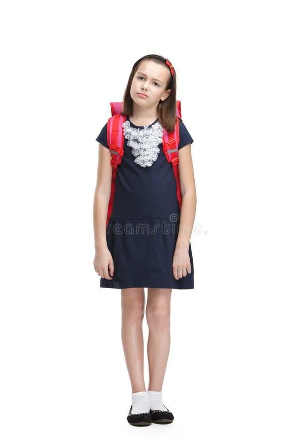 Vermoeid schoolmeisje met de aktentas stock fotografie
