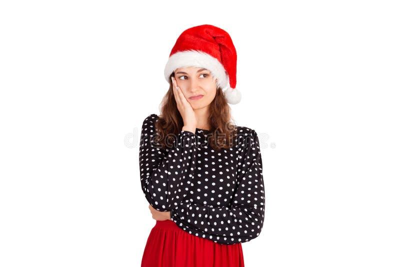 Vermoeide dromerige en sombere op palm leunen en womaninkleding die, die het denken omhoog staren emotioneel meisje in Kerstmisho stock afbeelding