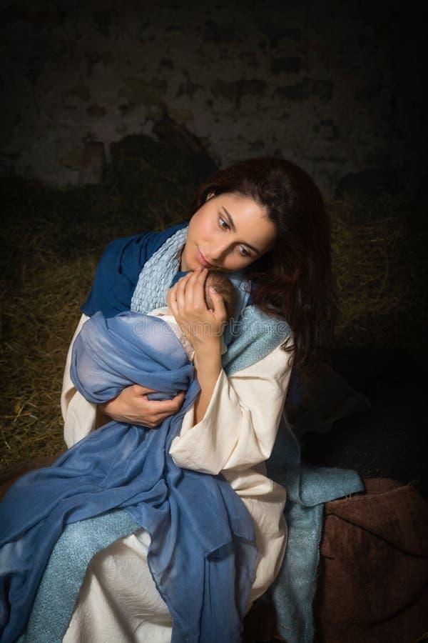 Vermoeide Moeder in geboorte van Christusscène stock fotografie