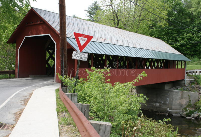 Vermont's Creamery Covered Bridge. Spans the Whetstone brook and is 80' long and 19' wide. It was constructed in 1879 with the sidewalk and slate roof added in royalty free stock photos