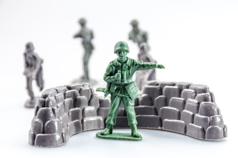 Vermoord van mini plastic Militairstuk speelgoed stock afbeeldingen