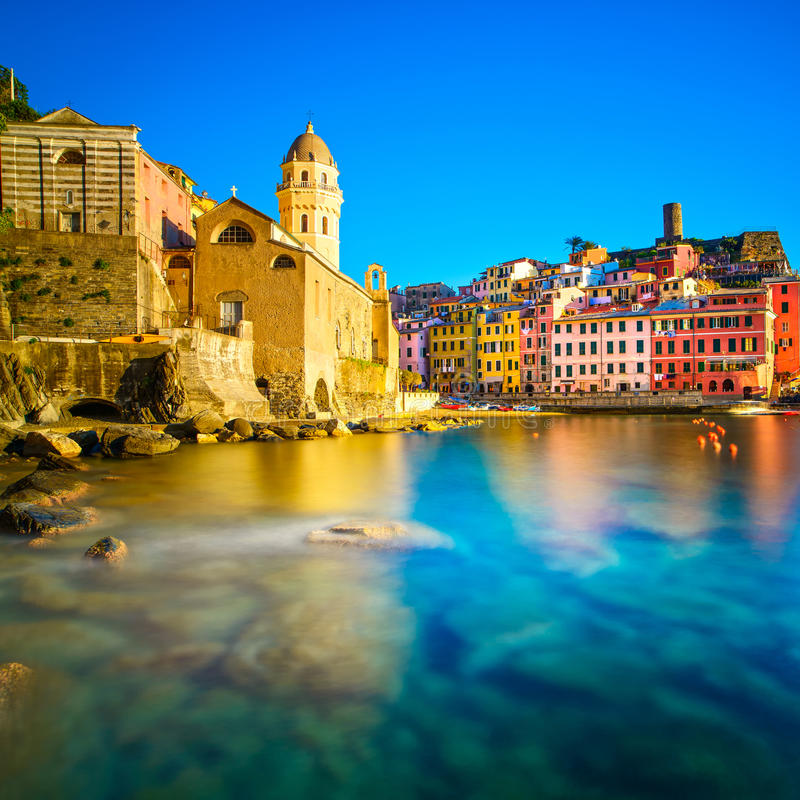 Vernazza village, church, rocks and sea harbor on sunset. Cinque Terre, Ligury, Italy stock photography
