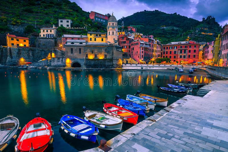 Vernazza village and harbor with colorful boats at evening, Italy stock image