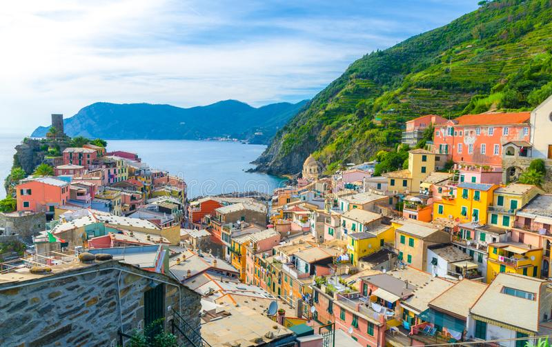 Vernazza village with typical colorful multicolored buildings houses, Castello Doria castle on rock, green hills and Genoa Gulf, L royalty free stock photos