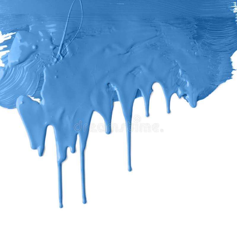 Vernice blu spessa della sgocciolatura fotografia stock