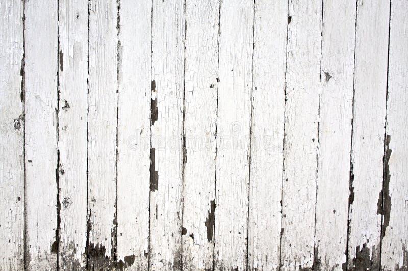 Vernice della sbucciatura sulla rete fissa di legno fotografia stock
