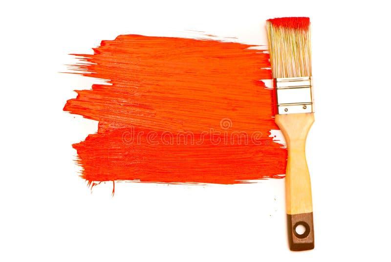 Vernice e spazzola rosse fotografia stock libera da diritti