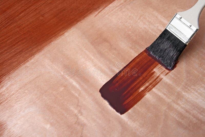Vernice fresca su superficie di legno immagine stock
