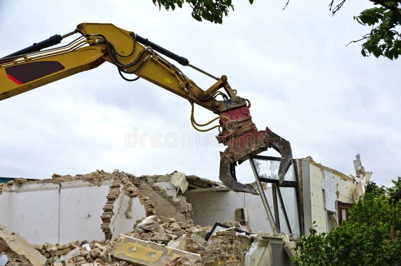 Vernieling van een woonhuis stock afbeelding