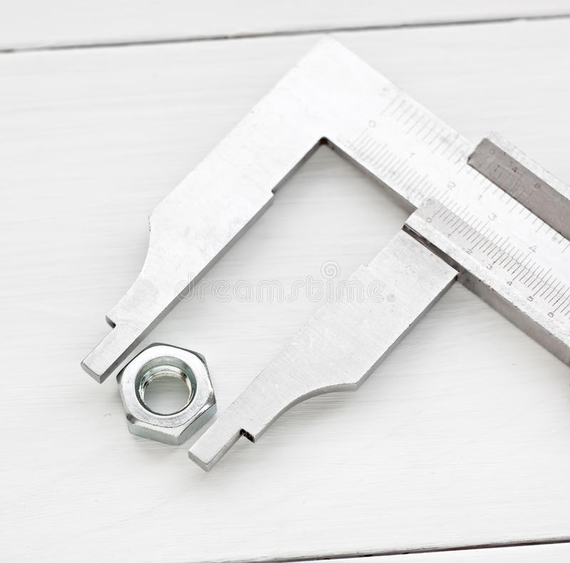 Free Vernier Precision Measurement Equipment And Nut Royalty Free Stock Image - 45906106
