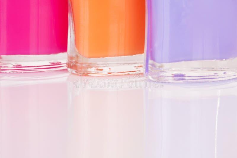 Vernis à ongles trois multicolore photo stock