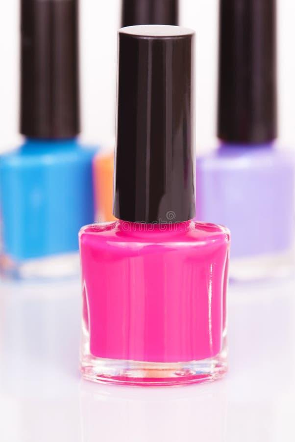 Vernis à ongles trois multicolore photographie stock libre de droits