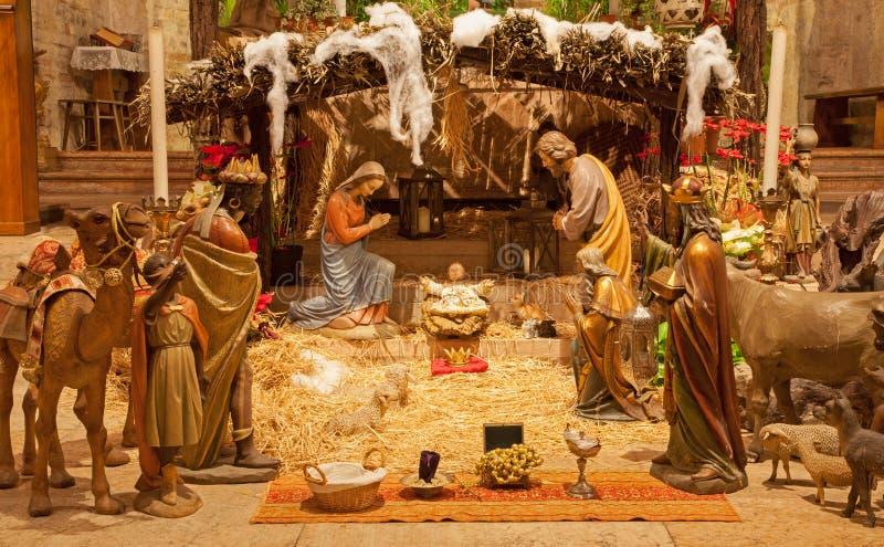 VERONA - JANUARY 28: Bethlehem in romanesque lower church San Fermo Maggiore on January 28, 2013 in Verona, Italy. stock photos
