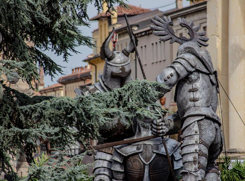 Verona, huge Roman gladiators positioned next to the splendid arena, along with other props, Egyptian statues or pirate cannons, a. Ll in full view of everything royalty free stock photo