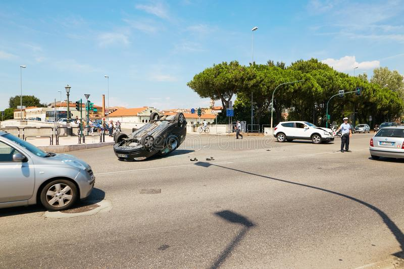 VERONA, ITALY - AUGUST 17, 2017: Auto accident at the crossroads of Verona streets. The car overturned. royalty free stock photo