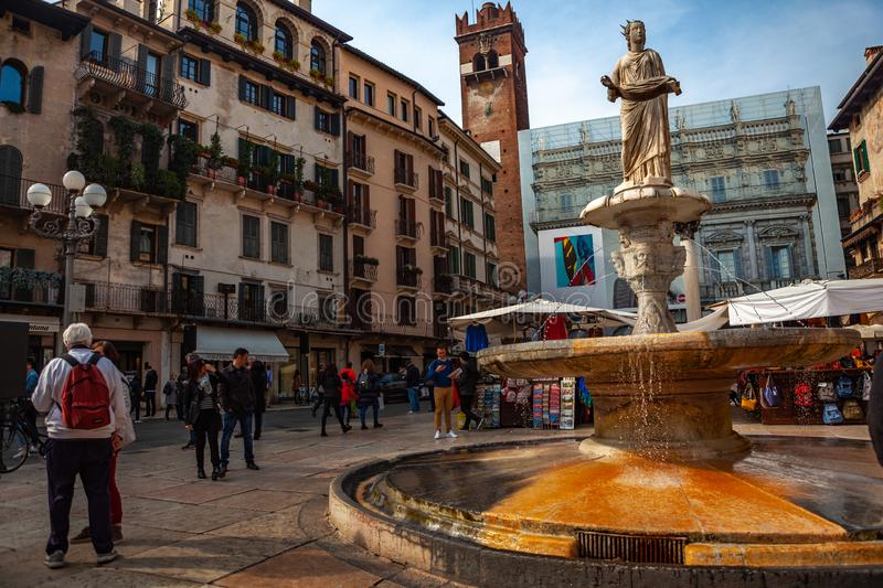 Verona, Italy – March 2019. Historic town square Elbe with stairs surrounded by cafes and buildings of peculiar architecture, royalty free stock photo