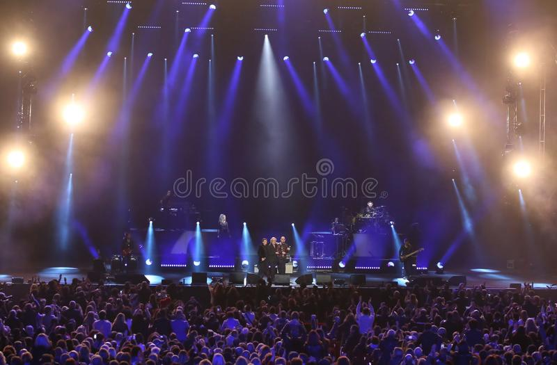 Verona, Italy - October 14, 2017: Live Concert of Umberto Tozzi. A famous Italian singer with other italian celebrities Morandi Gianni and Ruggeri Enrico and royalty free stock photos
