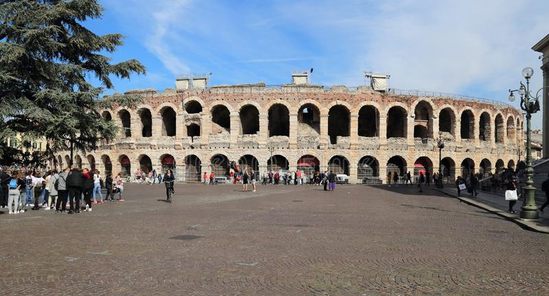 Roman arena in Verona, Italy. Verona, Italy - October 2, 2018: Young tourists at the ancient Roman arena on the Piazza Bra in Verona, Italy on October 2, 2018 royalty free stock photography