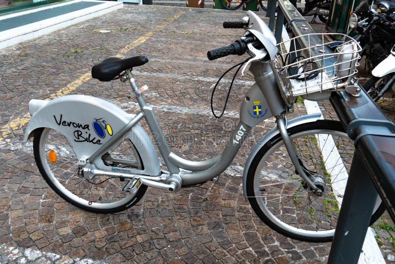 Bike sharing in Verona, Italy. Verona, Italy - September 5, 2018: Bicycle of the Verona`s environmentally friendly Bike Sharing service stock photo