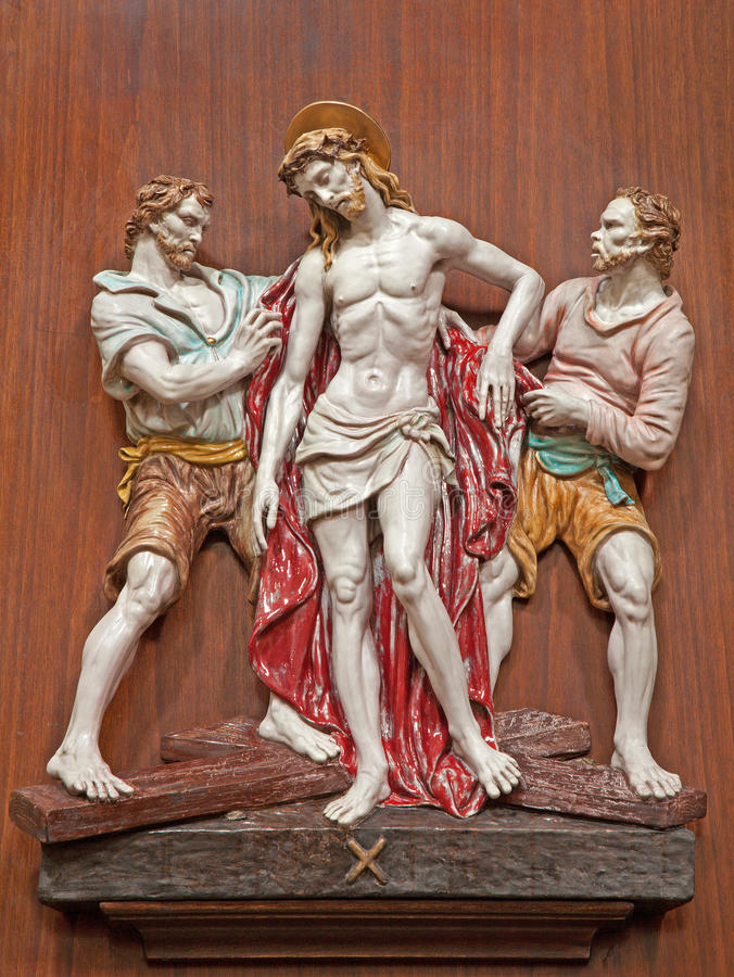 Verona - Jesus Stripped of His Garments. One part of ceramic coss way from st. Nicholas church. (Chiesa di San Nicolo) on January 28, 2013 in Verona, Italy royalty free stock photos