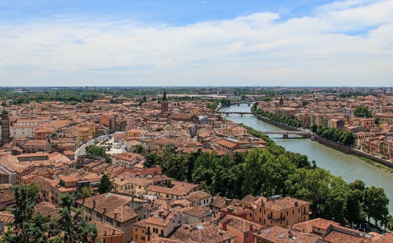 Verona skyline with Adige river at noon. Sant' Anastasia Church and Torre dei Lamberti (Lamberti Tower) also visible royalty free stock image