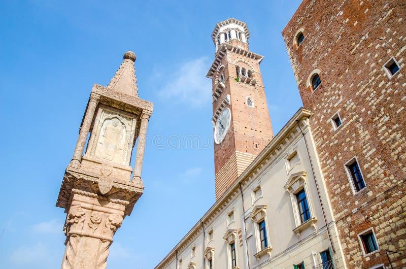 Verona Veneto Italy Colonna Antica and Torre dei Lamberti seen f. Rom Piazza delle Erbe square stock photography
