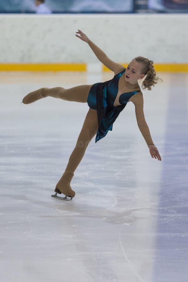 Veronika Ostapenko de Ucrânia executa o programa de patinagem livre das meninas de prata da classe III imagem de stock royalty free