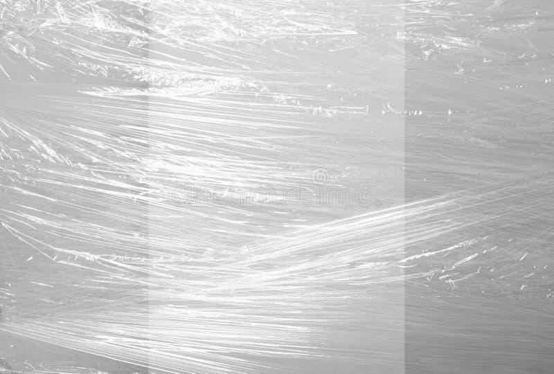 Verpackung den Plastikhintergrund beleuchtet in der Mitte lizenzfreies stockbild