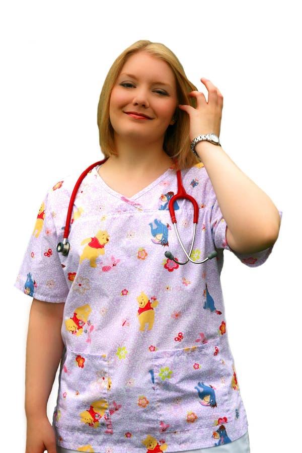 Verpleegster bij pasgeborenen stock foto