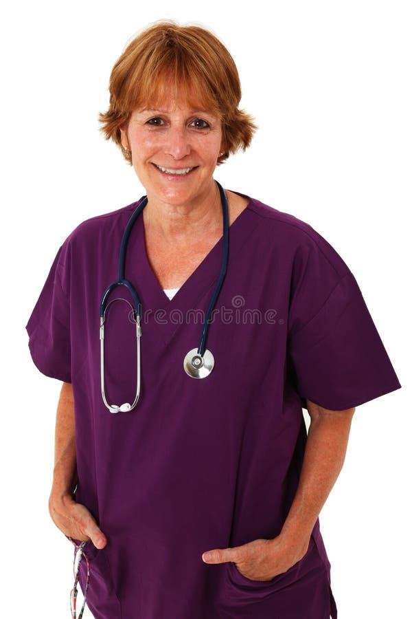 Verpleegster die bij Camera glimlacht royalty-vrije stock foto