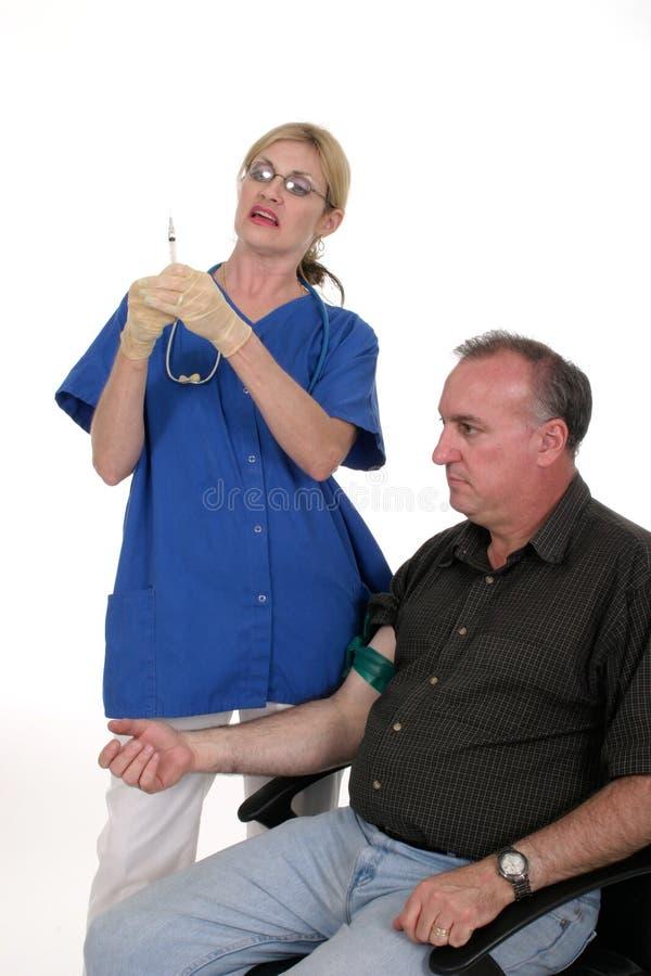 Verpleegster die Schot geeft aan Patiënt 1 royalty-vrije stock foto's