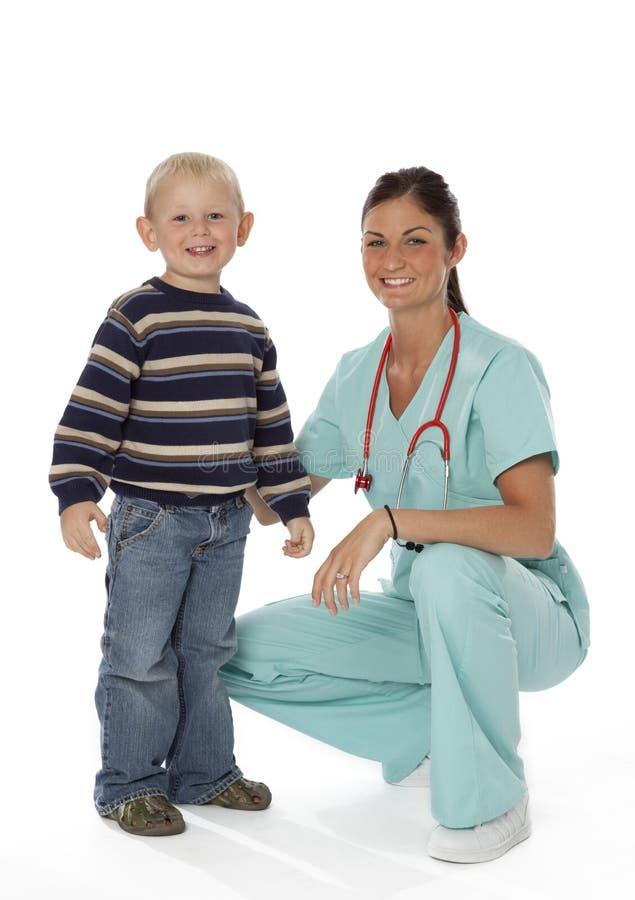 Verpleegster en Kind op Wit royalty-vrije stock foto