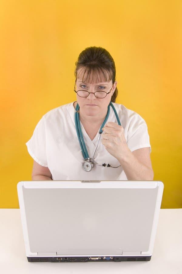Verpleegster met omhoog vuist royalty-vrije stock afbeeldingen