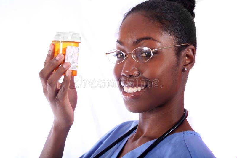 Verpleegster met Pillen stock afbeelding