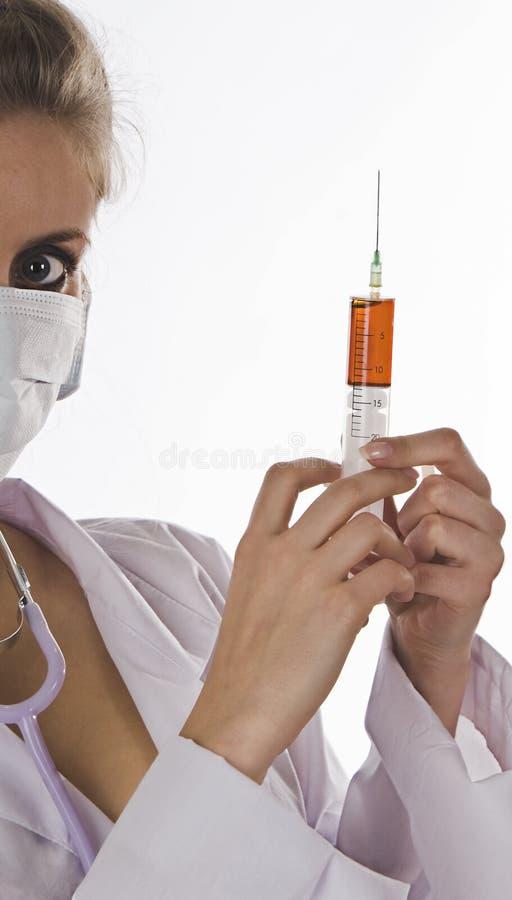 Verpleegster met spuit stock afbeelding