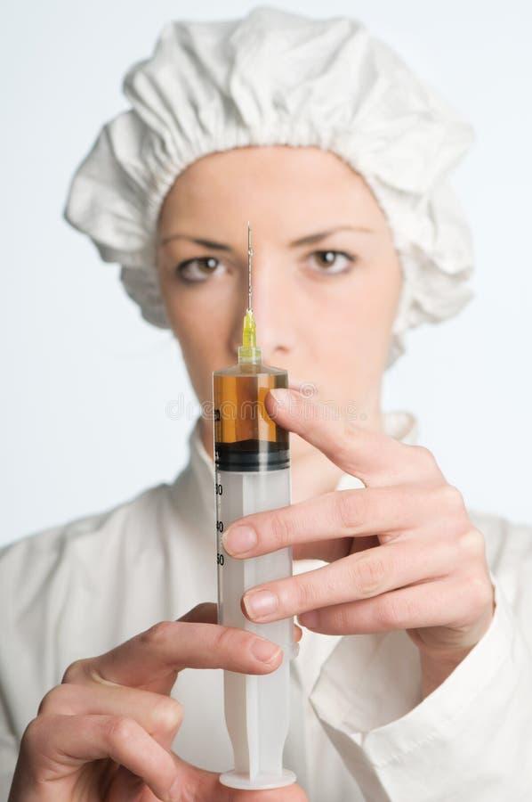 Verpleegster met spuit royalty-vrije stock afbeelding