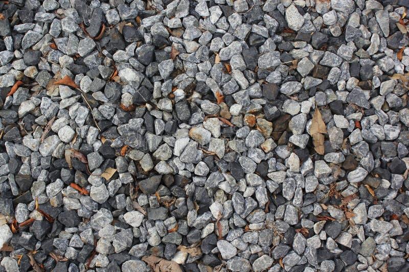 Verpletterde de textuurachtergrond van de steenrots stock afbeelding