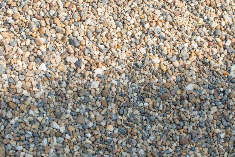 Verpletterde graniet en kiezelsteengrinttextuur stock afbeelding