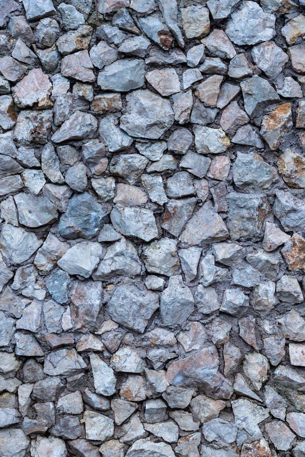 Verpletterde van de de Steenmuur van de Granietrots de Textuurachtergrond royalty-vrije stock fotografie