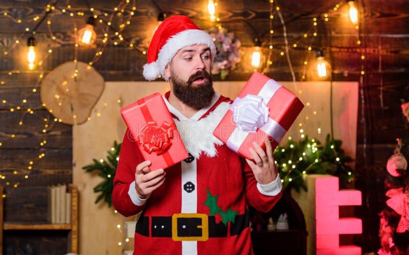 Verrassend winterwinkelen Erg hoffelijk santa hat santa-presentaties Kerstwinkelen stock fotografie