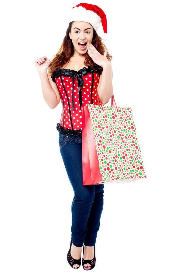 Verraste dame met het winkelen zak royalty-vrije stock foto's